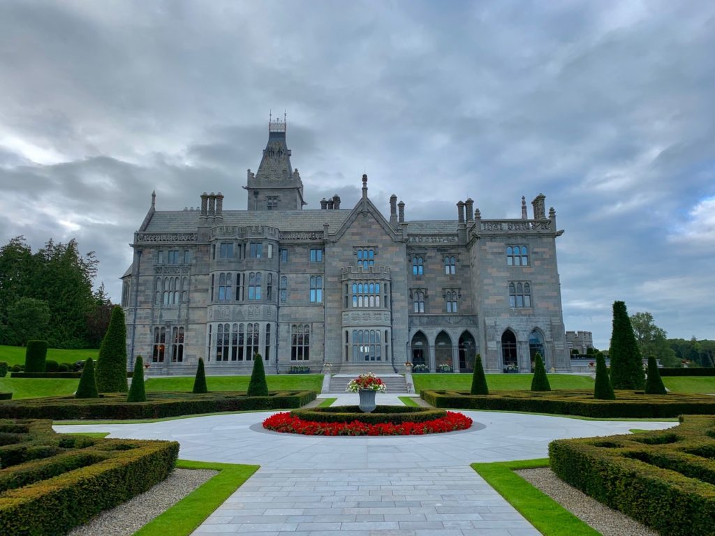 A beautiful view of Adare Manor in Ireland, looking up the front entrance.  Photo Credit: Travels with Gannon & Wyatt.