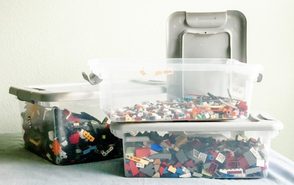 LEGO's in a plastic bucket showing one way how to organize children's toys.