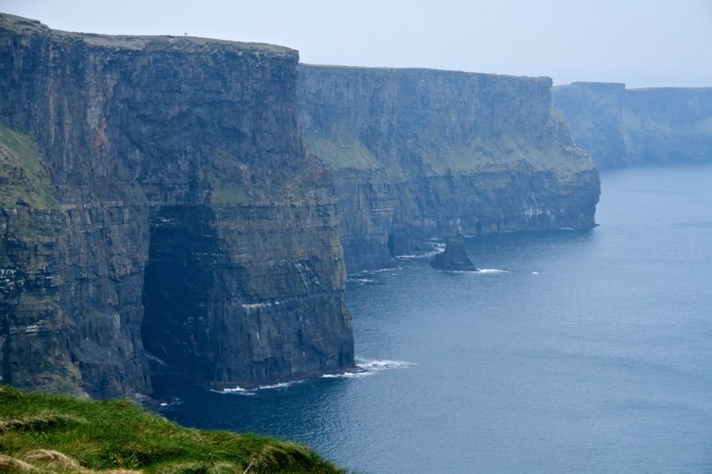 A photo of the cliffs dropping into the sea off the coast of Ireland.  Photo credit: Travels with Gannon & Wyatt.