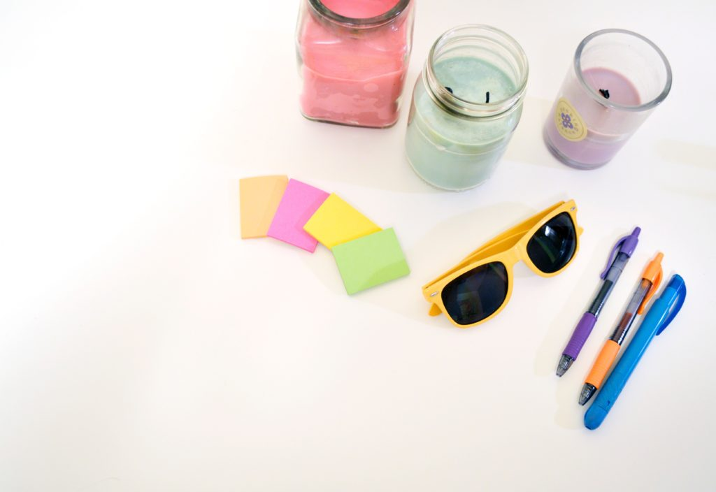 Items you would find in a car console: sunglasses, paper, pens, etc.