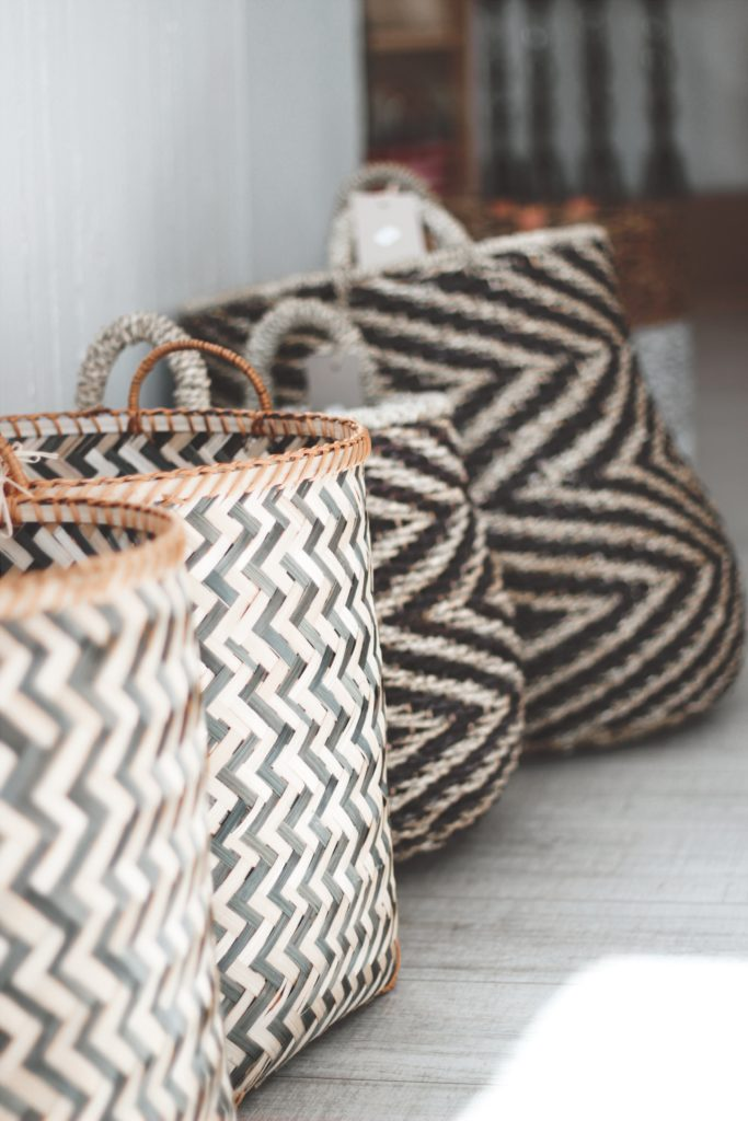 A line of woven baskets reminding you that a simple way to be organized is to streamline where stuff goes.