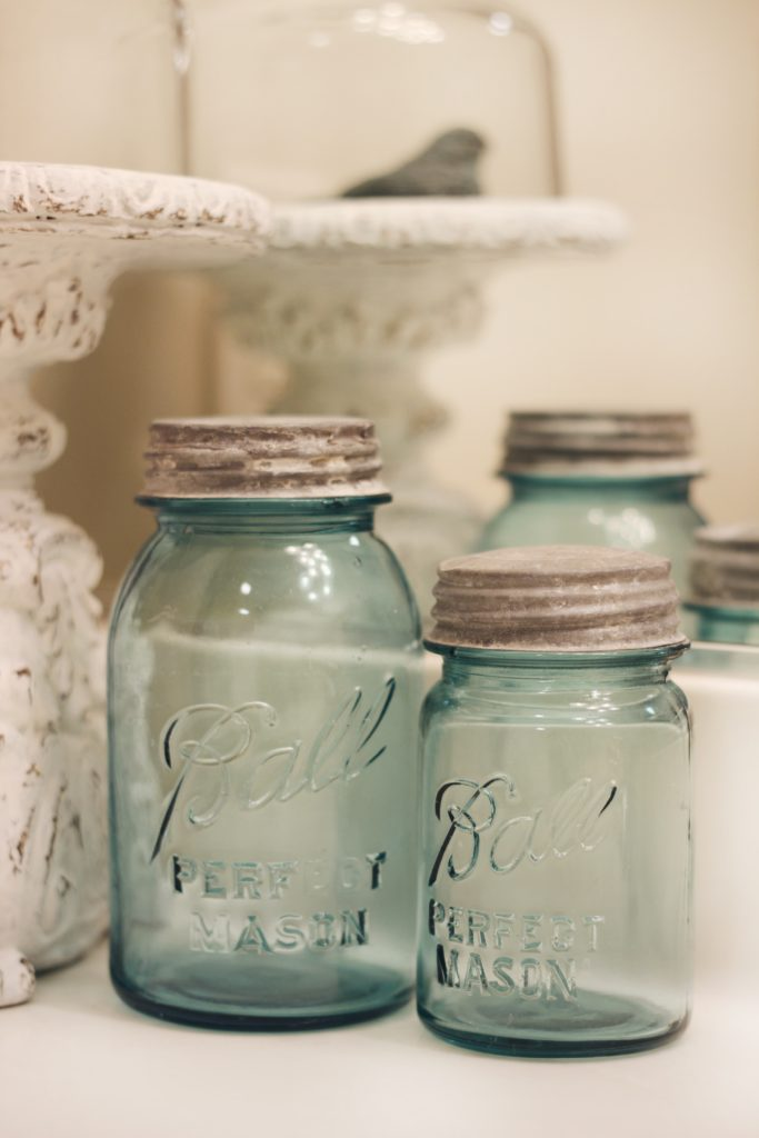 Three glass jars sitting next to each other to remind you that you only have so much time in your schedule.