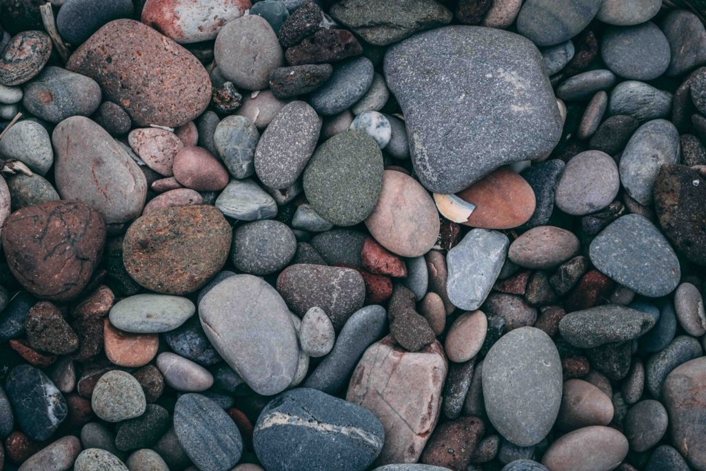 A close up photo of a pile of rocks, showing how creating a schedule can be demonstrated by rocks.