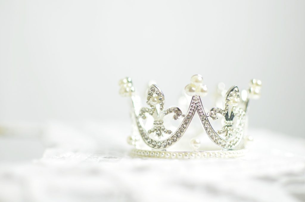 A silver crown sitting on a white background, like the king might wear in The Kidnapped King.