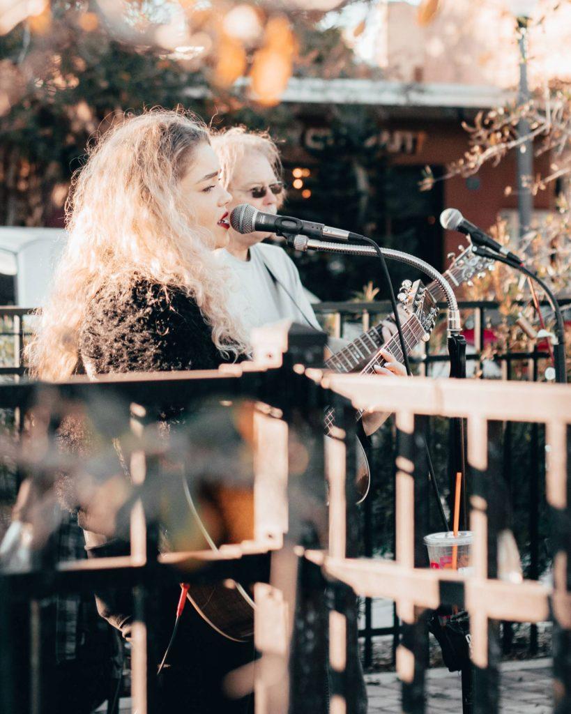 Singers giving an outdoor concert.