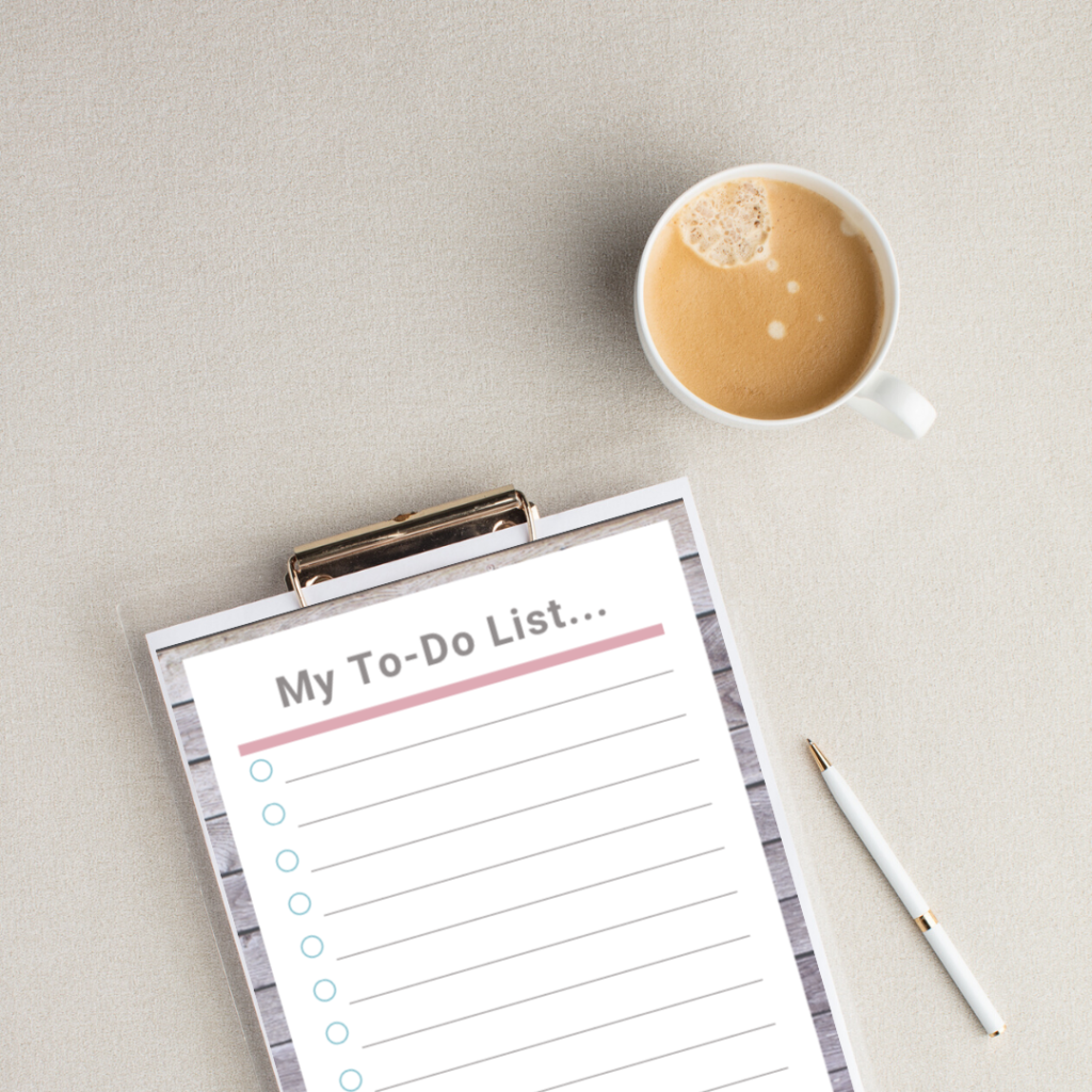 Clipboard with a Simple To Do List attached, sitting next to a cup of coffee. Template for the to do list is available as a free download.