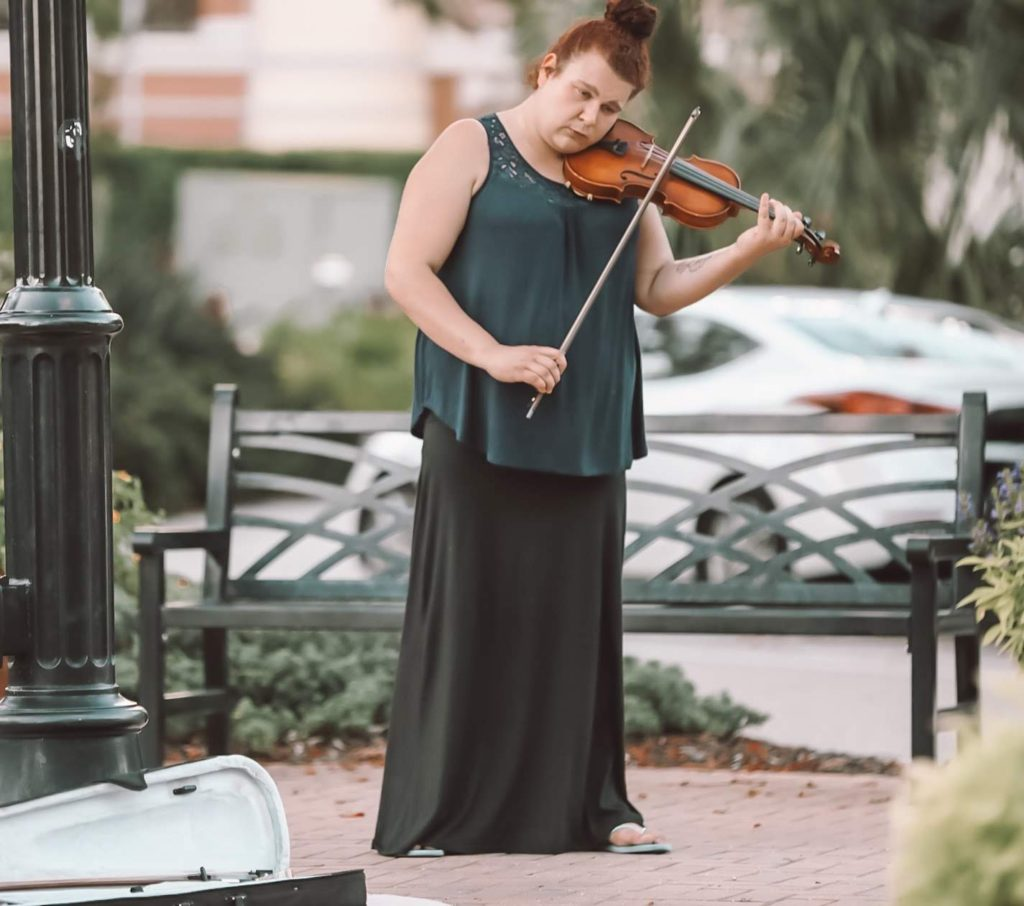 A violinist communicating through her music.