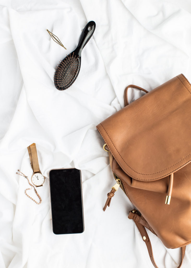 Picture of a backpack with items nearby.