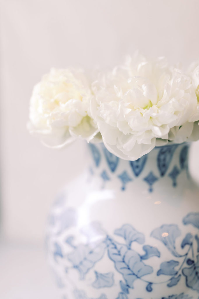 White flowers in a blue and white vase, reminding your that there is hope even when your heart is hurting.
