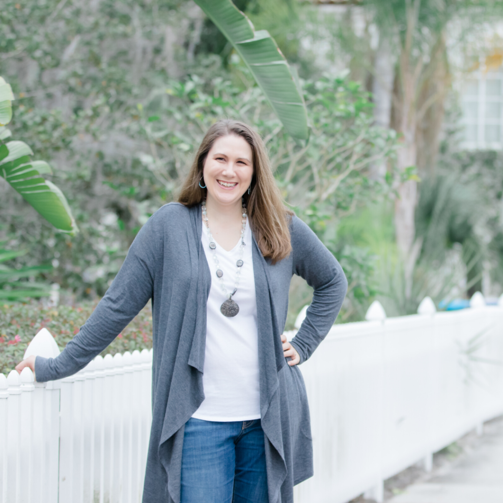 Elizabeth Tatham, founder of Inspiration in the Everyday, standing next to a fence.