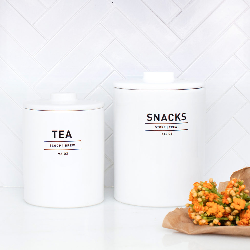 A tea and snack container sitting on a counter.