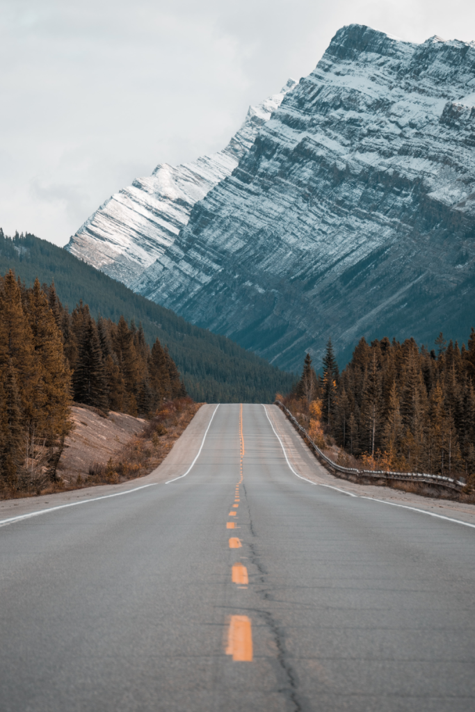A road leading into the snow-covered mountains.