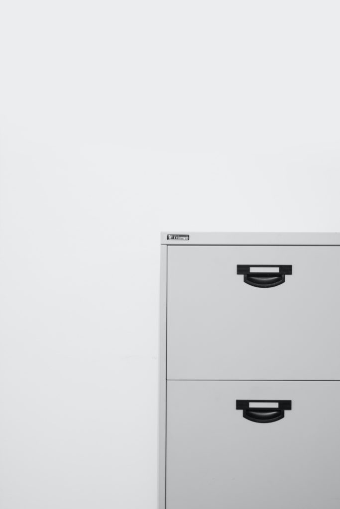 A example of a place where you can organize your paper clutter: A filing cabinet.