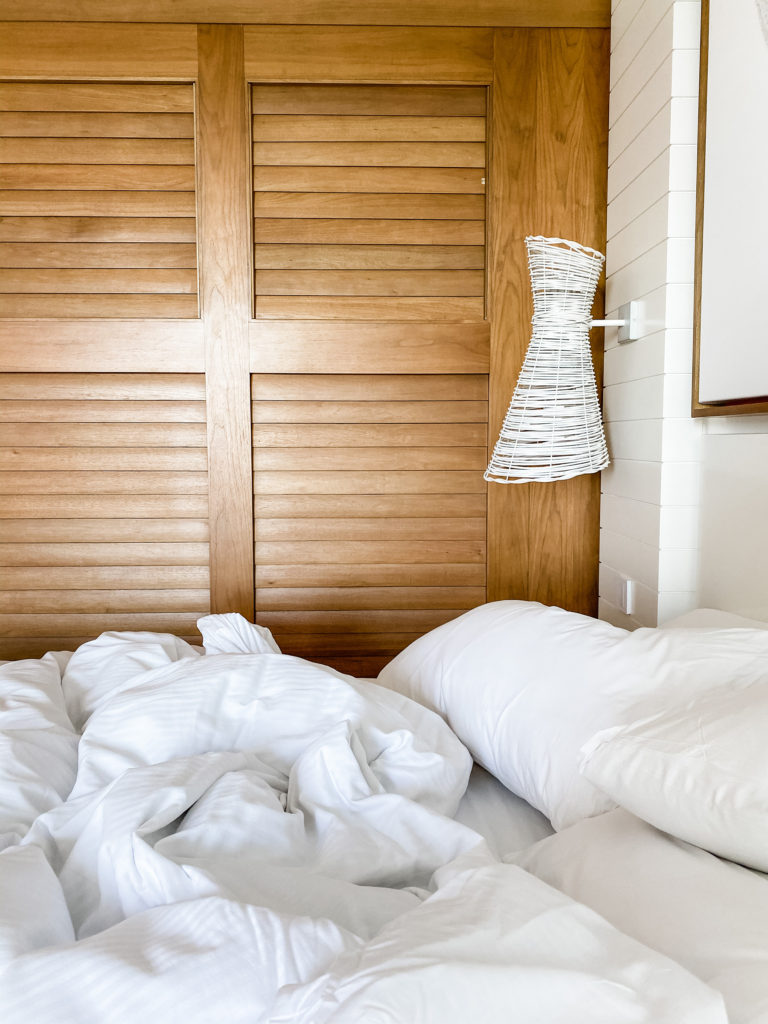 An unmade bed, symbolizing a portion of a morning routine that most people want to create.