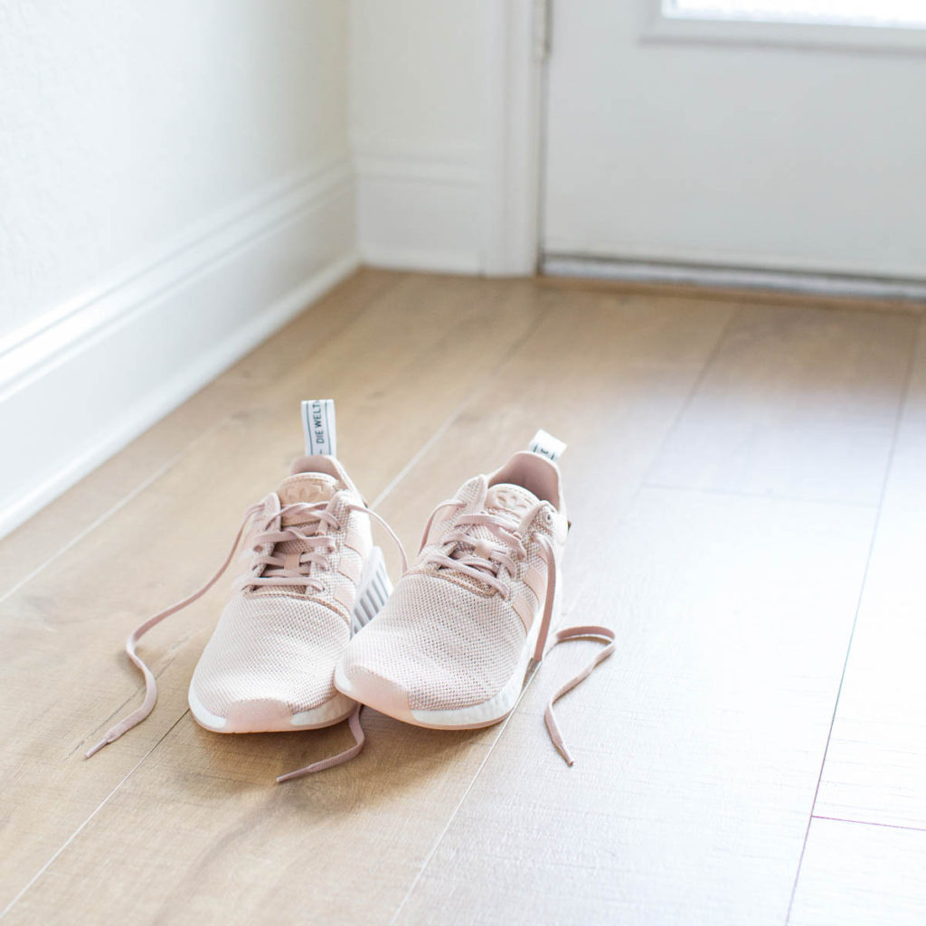 Pink workout sneakers symbolizing a part of a routine that most people want to create.
