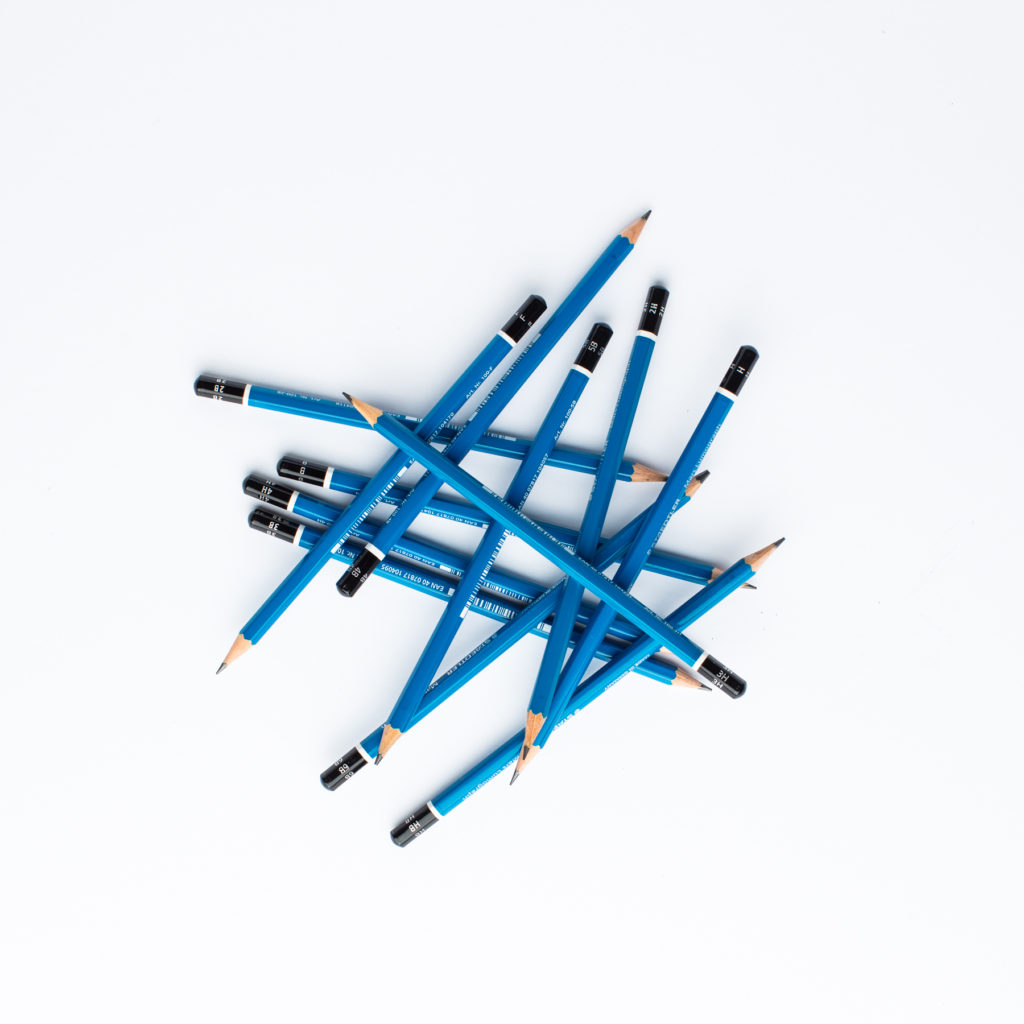 A pile of blue pencils jumbled together.