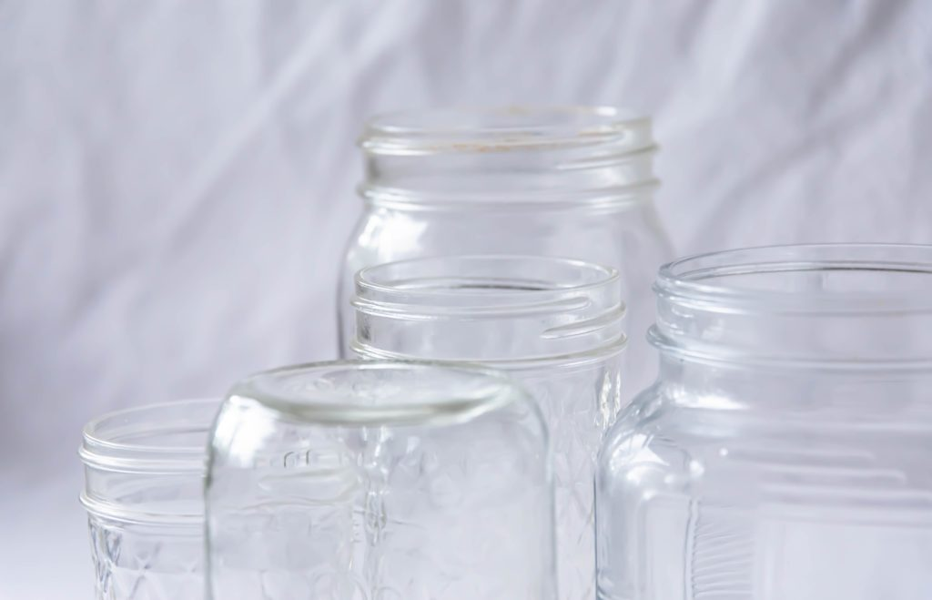 A grouping of clean mason jars, waiting to be filled with applesauce or apple butter.