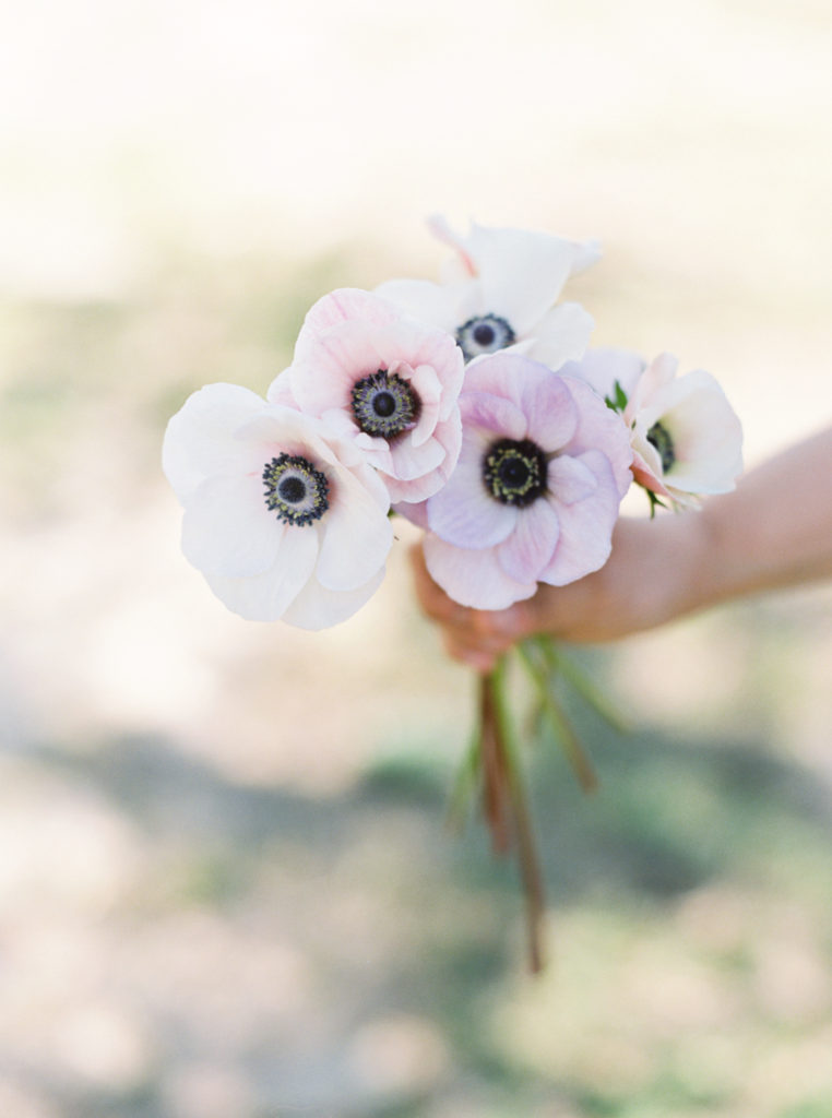 A bouquet of pink flowers being held together by their stems, reminding you that simple things can make you smile when you feel down.