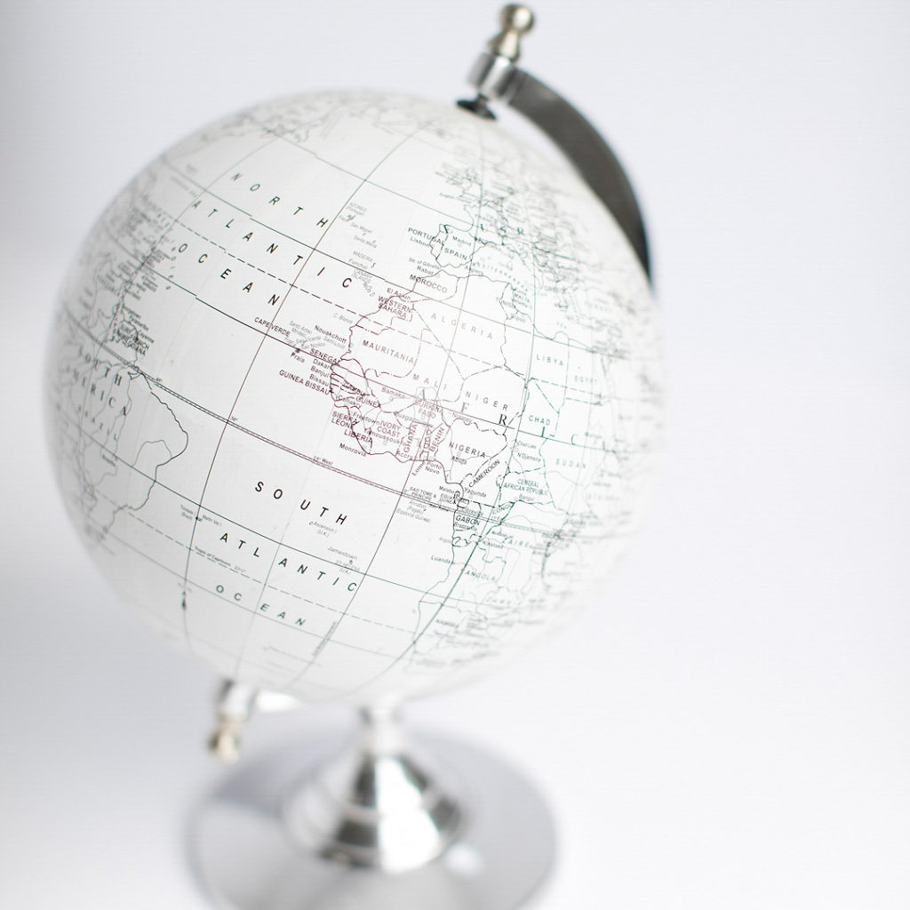 A while and gray scale globe of the world.