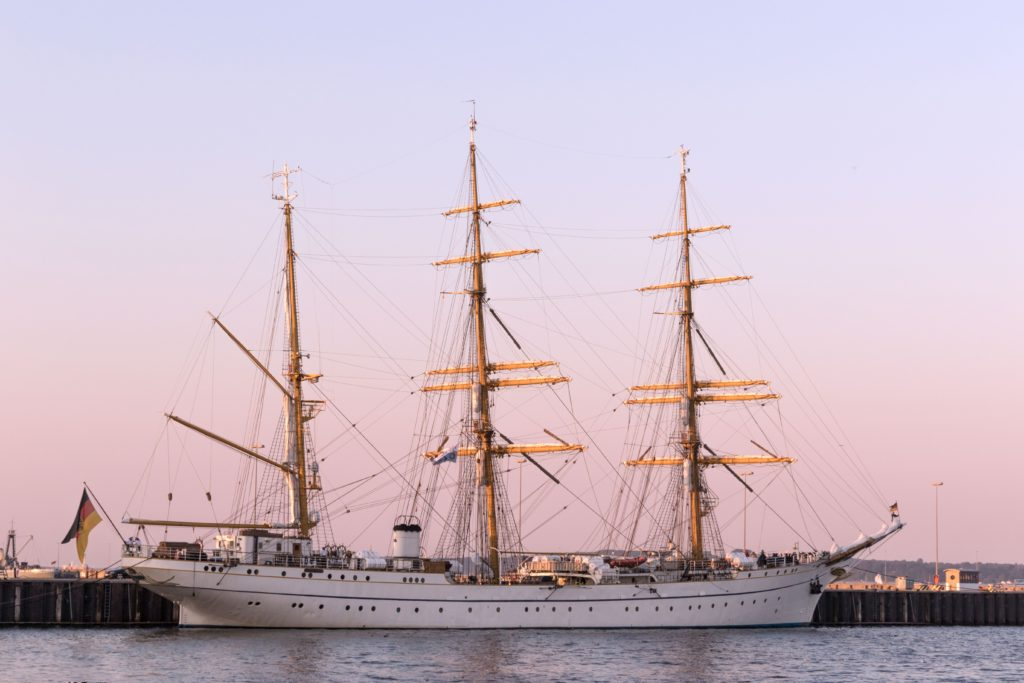 A steamer and sailing ship against the sunset.  This ship might be similar to one that Phileas Fogg traveled on.