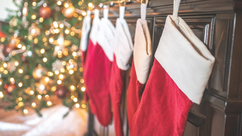 Red and white stockings hung by the mantle.