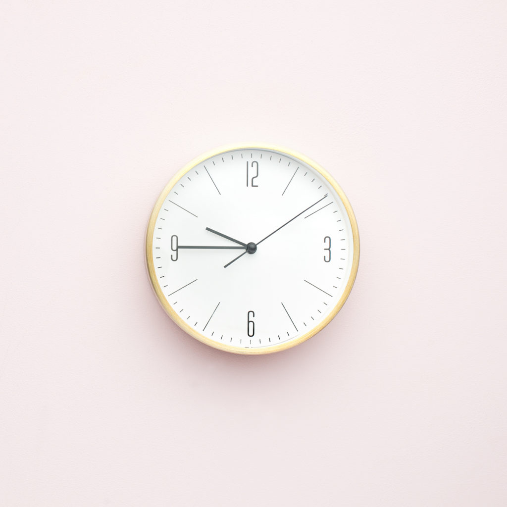 A clock on the wall showing you that being organized helps pattern your day.