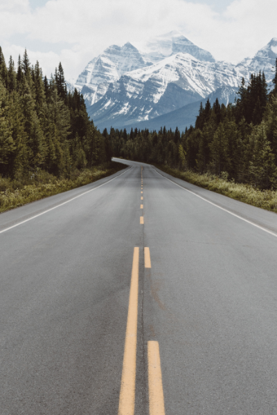 Picture of a road leading to the mountains.