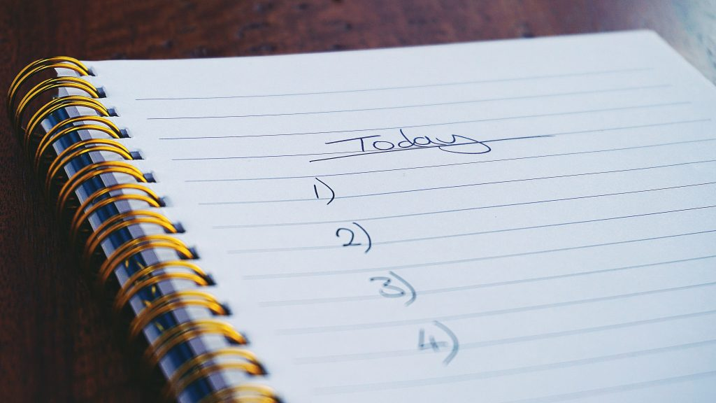A spiral bound notebook with the word 'Today' written on it, ready to record the homeschooling daily list.