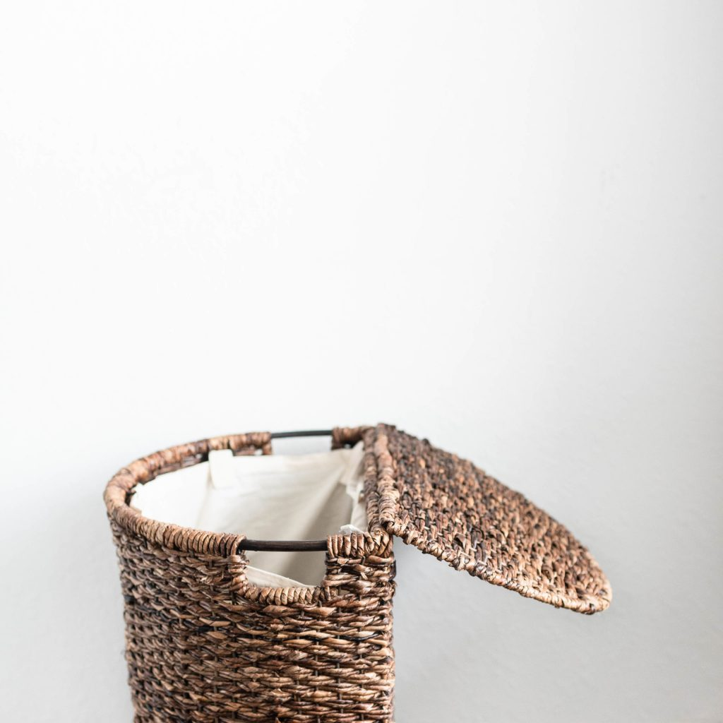 A wicker laundry basket showing that laundry is one of the important chores that needs to be done.