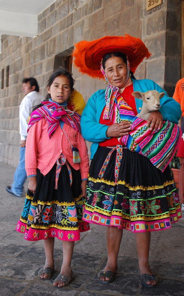 Ladies in Peru, brightly dressed in their traditional attire.