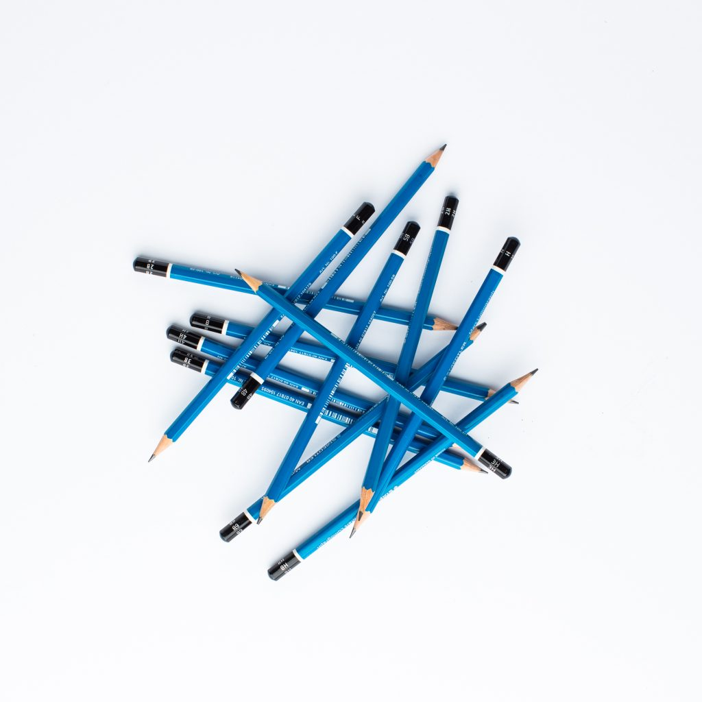 A jumbled pile of sharpened blue pencils.