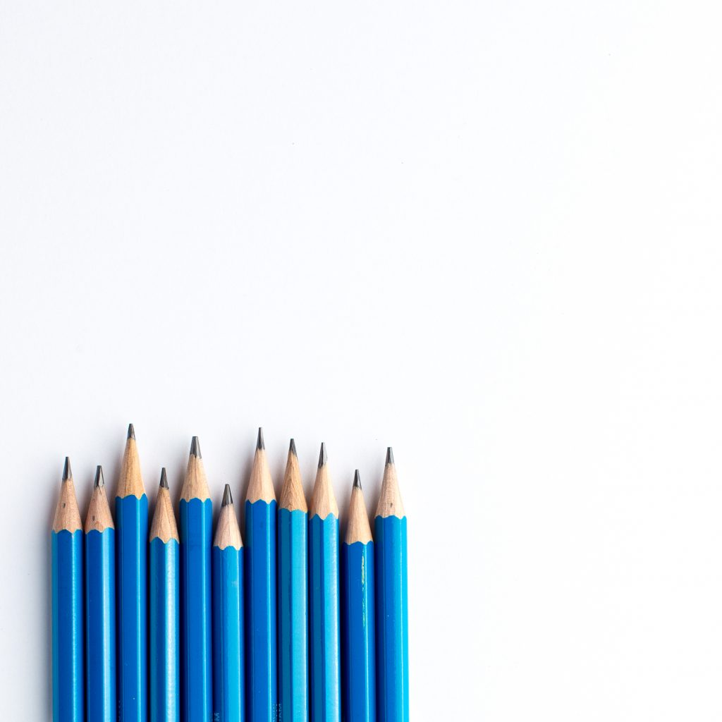A line of blue pencils, sharpened and ready to use.