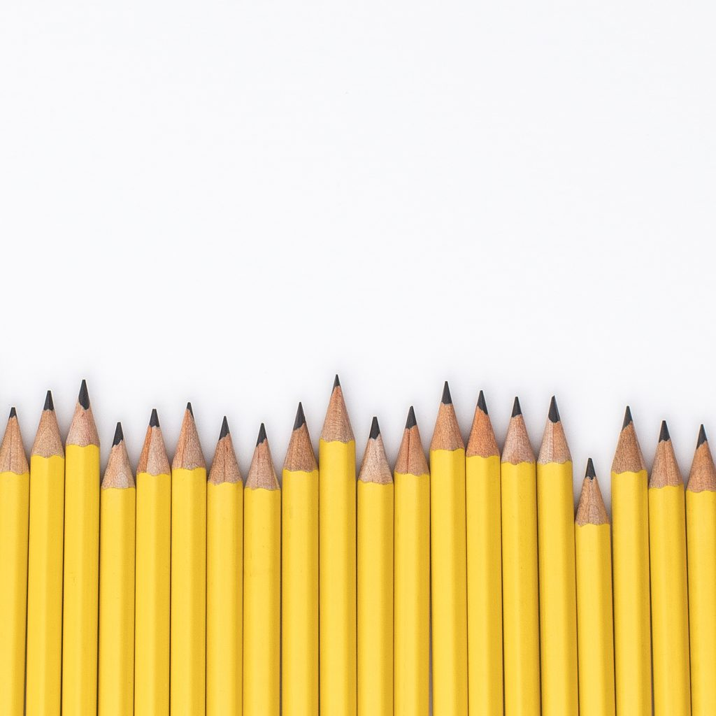 A line of yellow pencils all sharpened and ready to use in your homeschool.